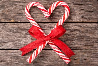 candy cane heart shape wrapped with red ribbon