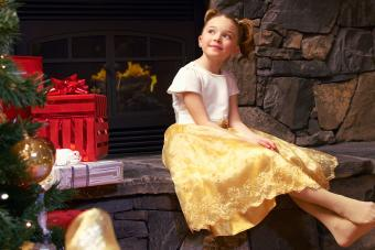girl wearing gold dress Christmas holiday