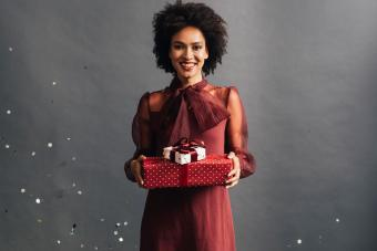 woman wearing burgundy dress for Christmas holiday