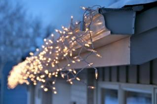 Outdoor Christmas lights installed along eaves
