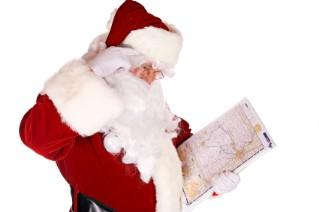 Santa plotting his Christmas Eve route