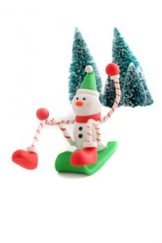 snowman figurine sledding