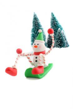 snowman figurine sledding