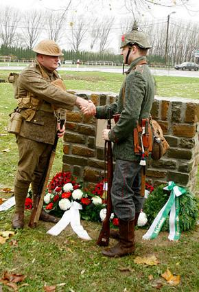 """Christmas truce photo """"Soldiers shake hands at the memorial"""" courtesy of Alan Cleaver"""