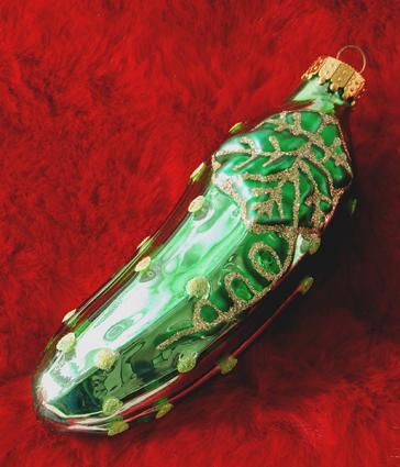 Christmas pickle on red background