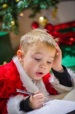 Boy writing Santa a letter