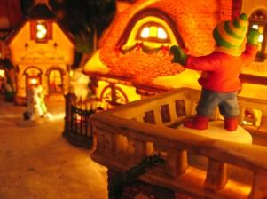a lit miniature christmas village display makes a great mantle decoration - Miniature Christmas Town Decorations