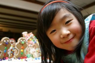 Asian girl with gingerbread Christmas decorations