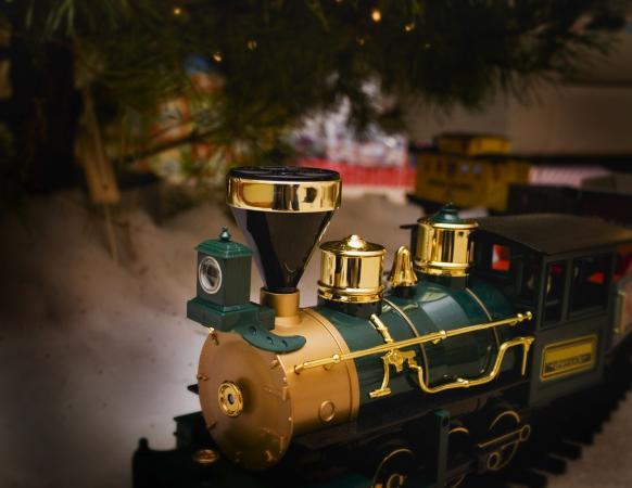 Train below Christmas tree