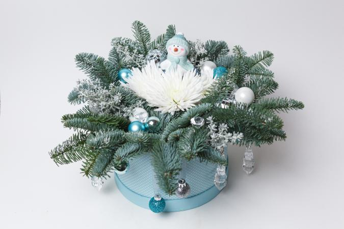 Snowman and evergreens centerpiece