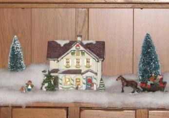 Image of a Christmas village house with figures