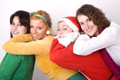 Christmas Santa girl and friends smiling