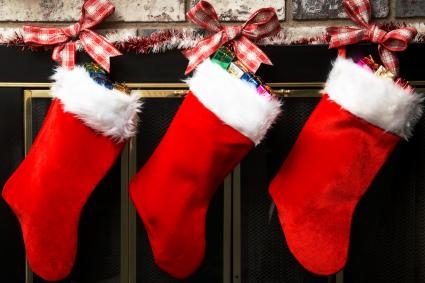 Christmas stockings hanging on a fireplace