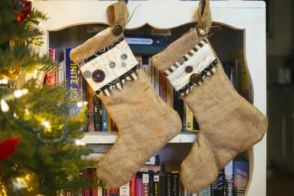 Stockings hanging on bookcase