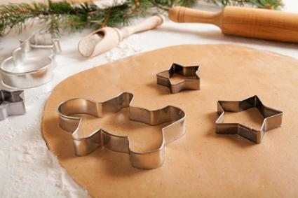 Christmas cookies cutters on dough