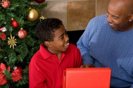 Father giving teen son a Christmas gift