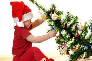 baby decorating a small tabletop christmas tree - Christmas Decorations For Small Trees