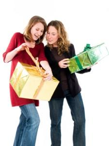 Two women having a Christmas gift exchange