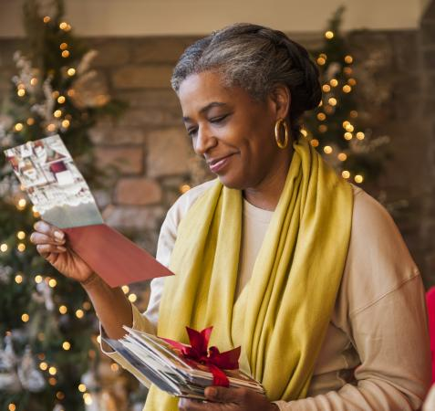 African American woman reading Christmas card