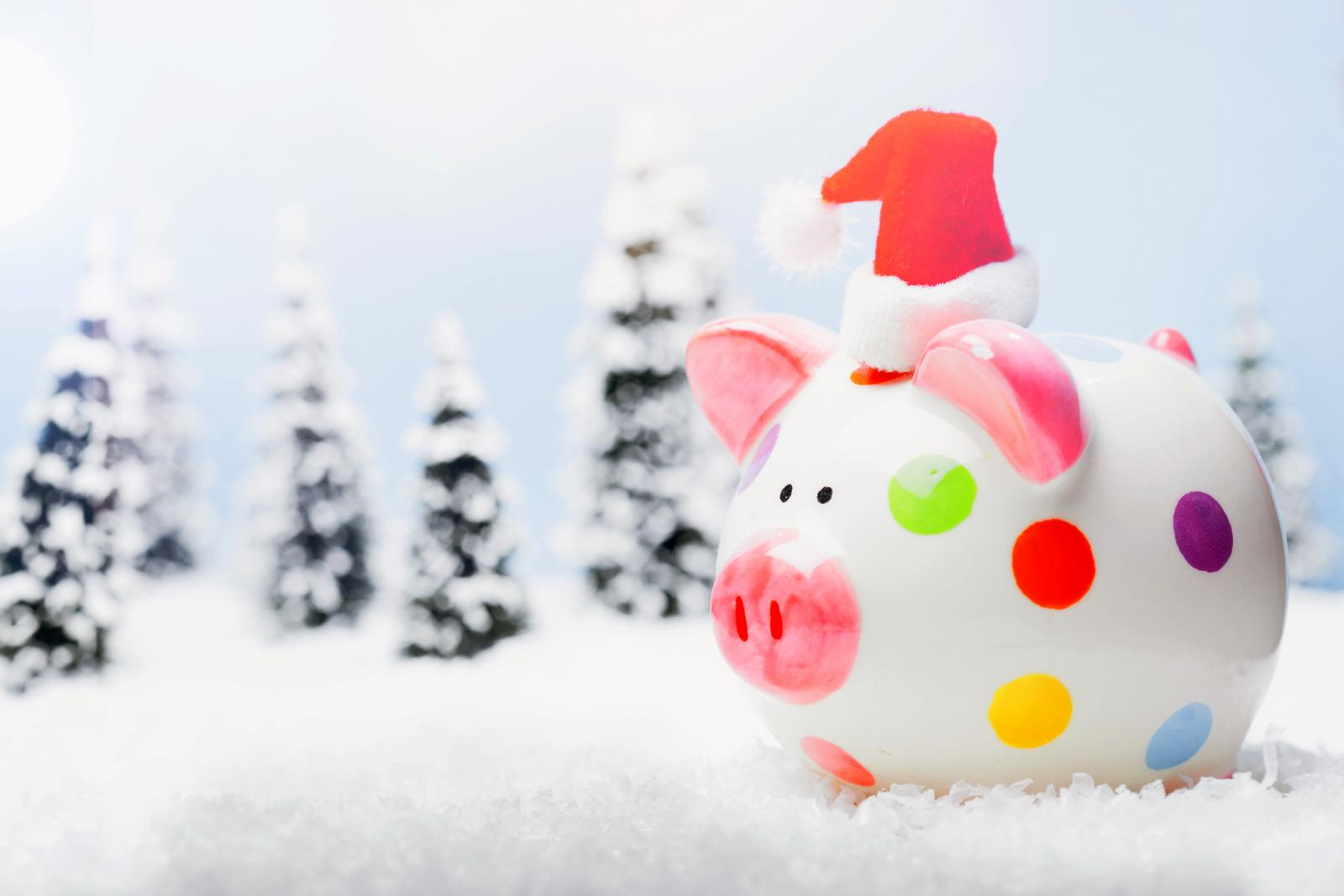 Saving money at Christmas, piggy bank in the snow