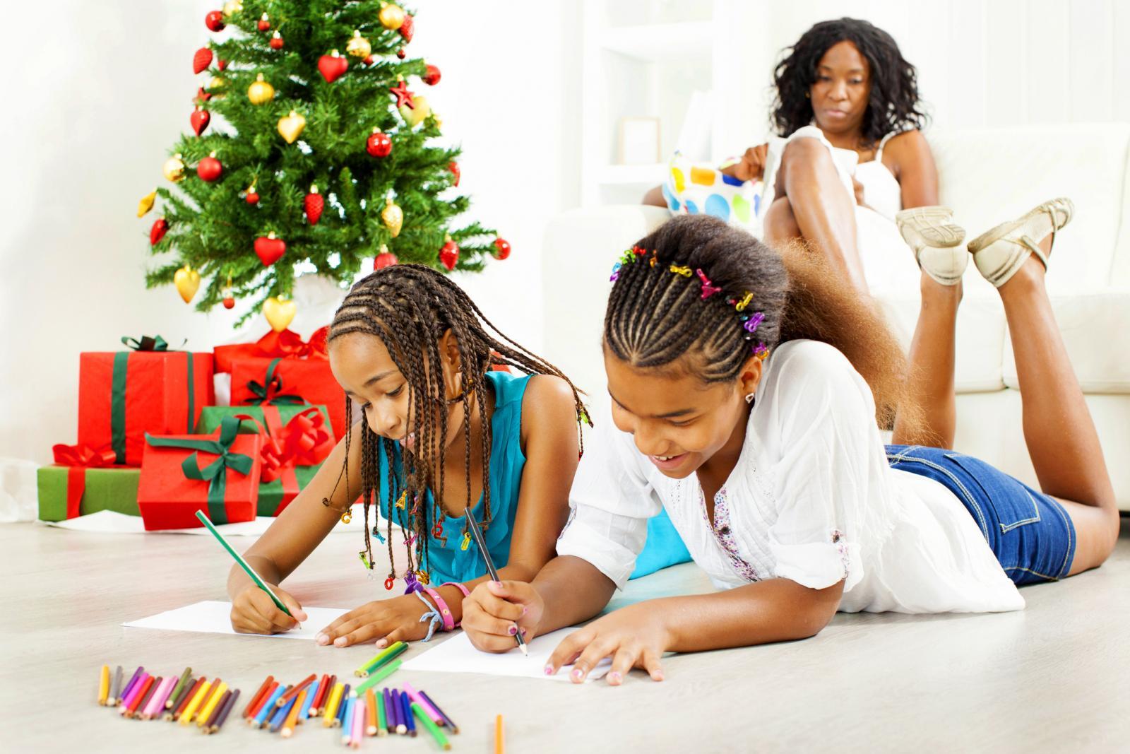 girls coloring at Christmas