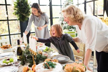 Lighting candles for Women's Little Christmas