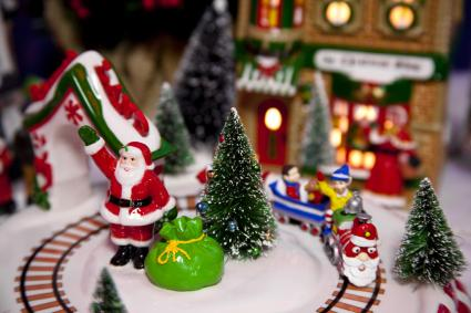 Miniature Christmas scene with Santa and toy bag train