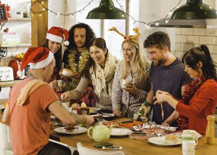 Friends preparing breakfast in the kitchen on Christmas morning