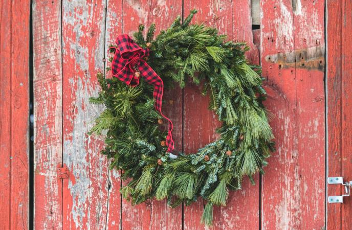 Christmas Wreath Hanging on Red Barn Door