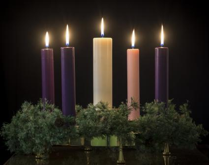 All five candles lit on an advent wreath