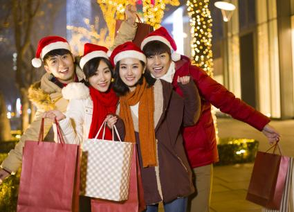 Happy young friends shopping for christmas