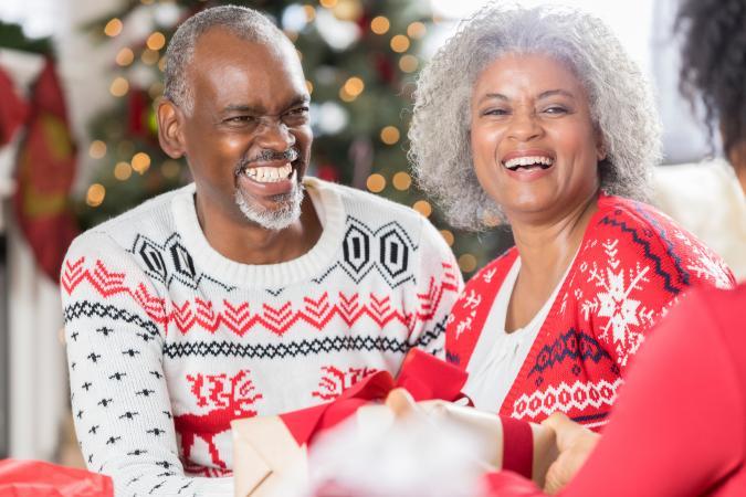Happy senior couple spending Christmas with family