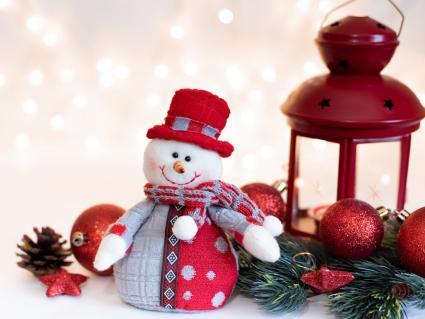Snowman with a lantern