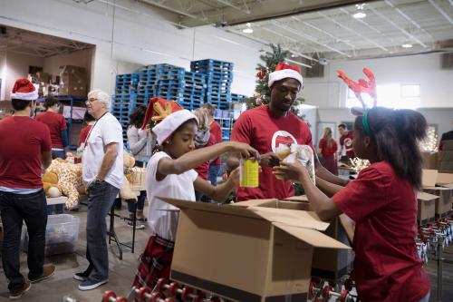 Family in Santa hats volunteering