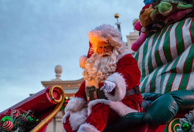 Waving Santa Claus on carnival-float