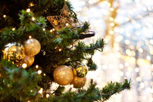 Gold ornaments on Christmas tree