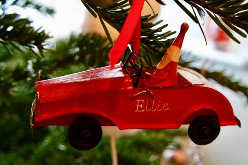 Santa driving car Christmas ornament