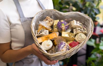 Woman holding spa gift basket