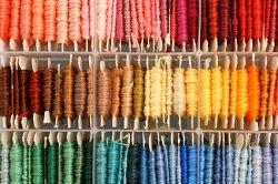 string organized by color in a craft room