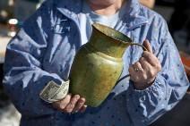 a green vase at a garage sale
