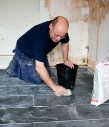 man putting sealer on slate floors to keep them clean