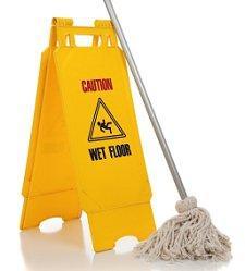 wet floor sign to clean a terrazzo floor