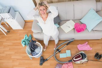 Woman in chaotic living room