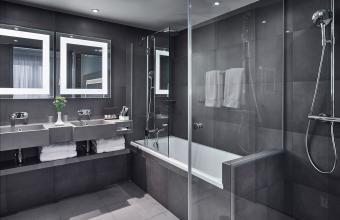 Modern bathroom showing sink and shower
