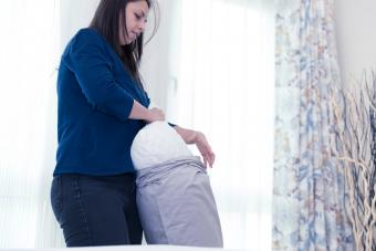 Woman changing pillows cases