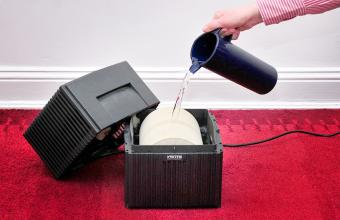 Air humidifier being cleaned
