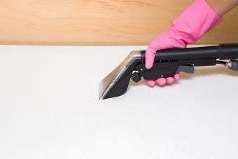 Vacuuming the mattress