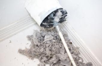 Lint being removed from a dryer vent