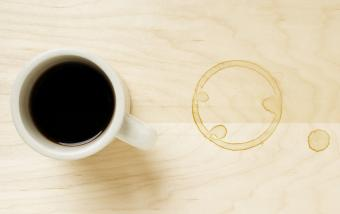 Cup of coffee and coffee ring on table