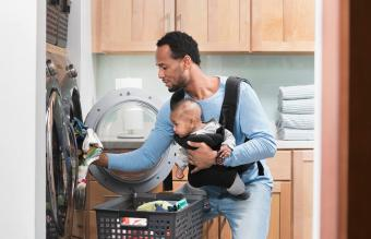 father doing laundry